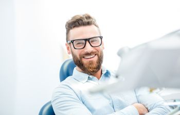 Satisfied middle-aged man in a dental chair.