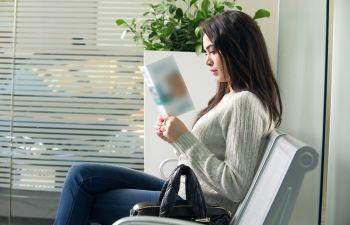 woman reading a brochure