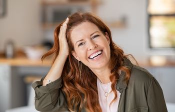 Happy middle-aged woman with perfect smile.