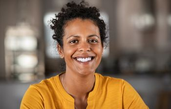 Middle-aged Afro-American woman with perfect smile.